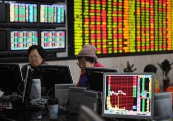 印股票換鈔票 華爾街狼群吸金20億