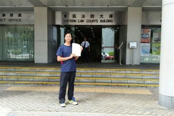 台法輪功學員遭誣告 港警羈押兩夜