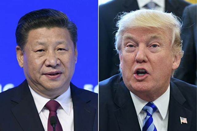 美國總統川普(特朗普)20日在一場新聞發布會上,讚揚北京在解決「朝鮮威脅」上所做的努力,並相信習近平會非常努力。(FABRICE COFFRINI,MANDEL NGAN/AFP/Getty Images)