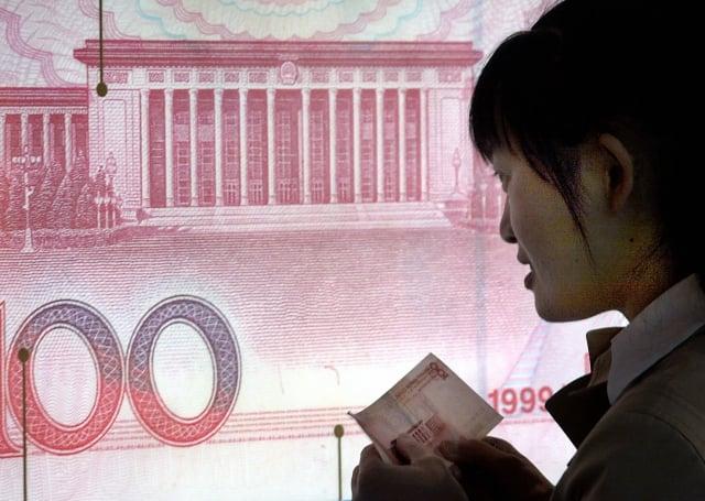 人民幣國際化不順,降為全球第六支付貨幣。(Getty Images)