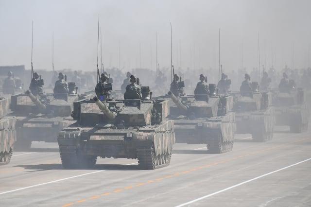 習近平在十九大上,對於解放軍的強軍目標定了3個時間點,包括2020年基本實現機械化等。(中央社)