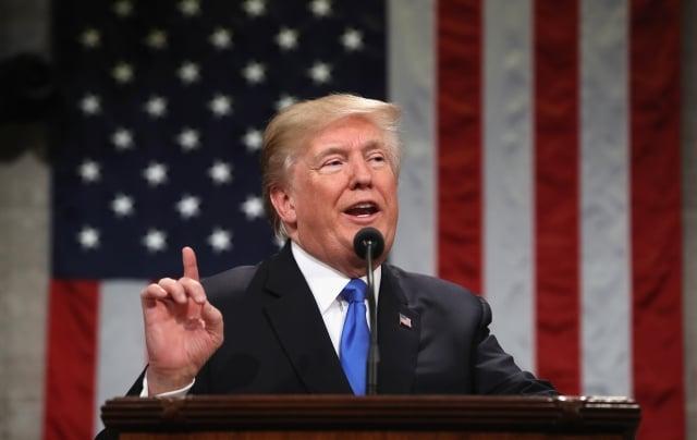 美國總統川普以「國家安全」為由,於台灣時間13日發布行政命令,禁止晶片大廠博通收購其競爭對手高通。(Win McNamee/Getty Images)