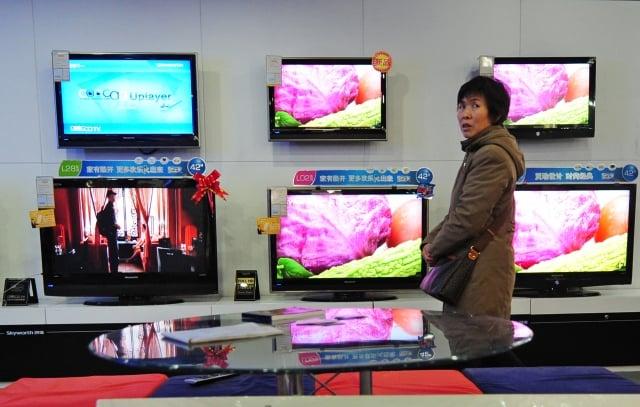 6兆元中國商品清單中,在工業產品方面,除了與「中國製造2025」計畫有關項目,也包括電視機、電冰箱等民生用品。圖為中國家電示意圖。(FREDERIC J. BROWN / AFP)
