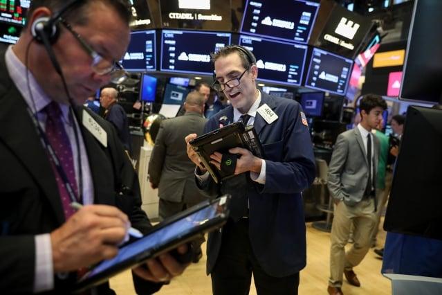 受稅改和公司強勁現金流提振,美股今年股票回購規模較2017年成長46%。(Getty Images)