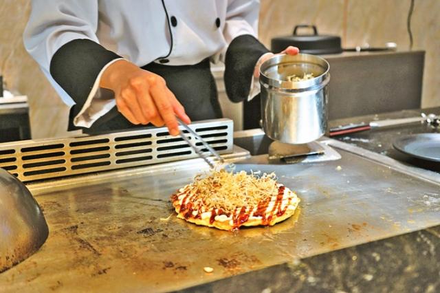 知名的御好燒,在美國被稱作「 日本披薩 」。(Fotolia)