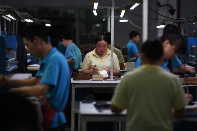 近來中國經營環境惡化,台商的中國夢碎,紛紛撤資,以廣東為例,早已出現「逃命潮」。圖為示意圖。(AFP)