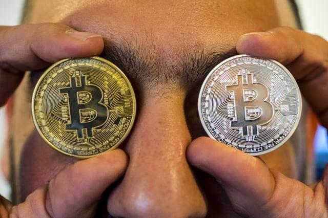 比特幣價格再創新低,跌破4千美元大關。圖為示意照。(AFP)