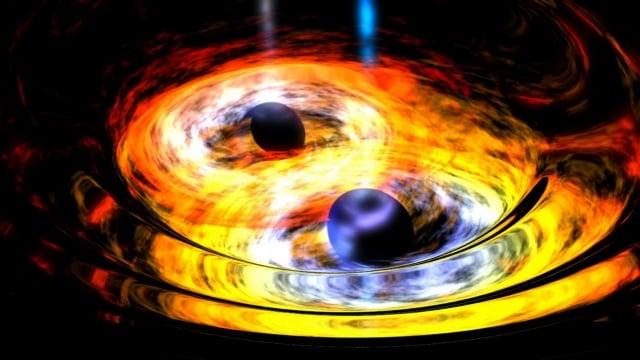 科學家發現迄今最大的黑洞碰撞事件。圖為藝術家筆下,兩個黑洞進行合併的示意圖。(NASA)