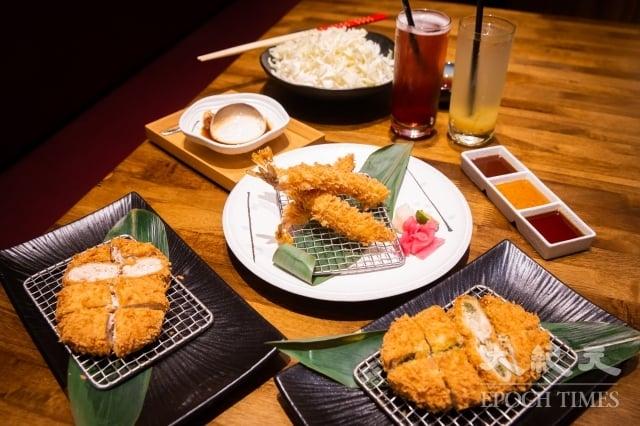 日本品牌「晴木千層豬排」將超薄切豬肉片層層堆砌,沾附生麵包粉,低溫油炸後垂直靜置,讓熱氣均勻擴散到內部,口感外脆內嫩多汁。