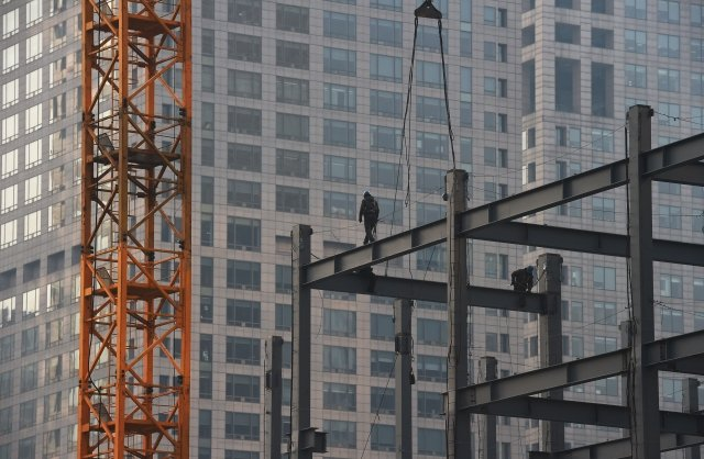 中國房企今年將有4,026億元人民幣的地產債到期,分析認為,今年房企或爆發大面積違約潮。(Getty Images)