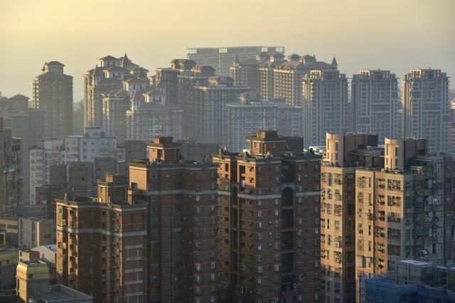 台灣房市達人Sway引電影《侏儸紀公園》為例,指陸資就像恐龍,利用它小心最後被吃掉。圖為示意照。(Chris STOWERS / AFP)