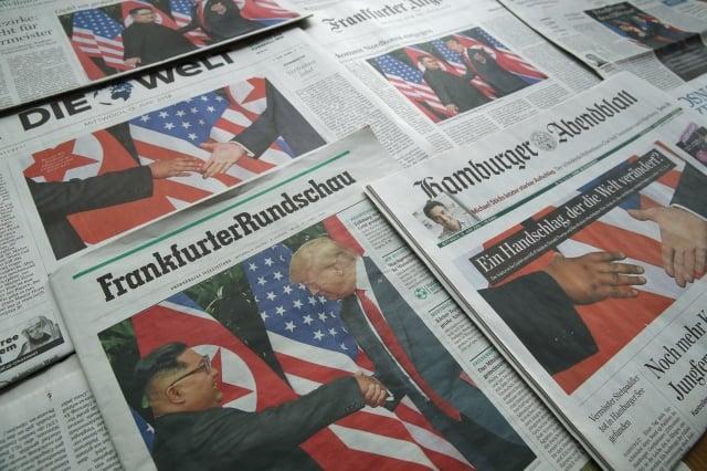 去年6月,德國媒體大幅報導首次「川金會」。(Getty Images)