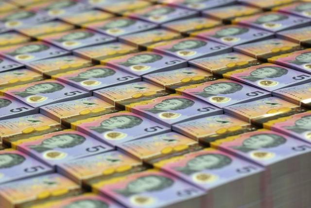 美國媒體報導,中國大陸的經濟加速放緩,有兩國的貨幣受此影響最大,分別是澳元和紐元。圖為澳元。(AFP)