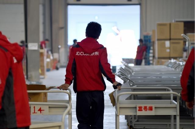 中國大陸知名電商京東公司再度傳出大裁員的消息。圖為示意照。(AFP)