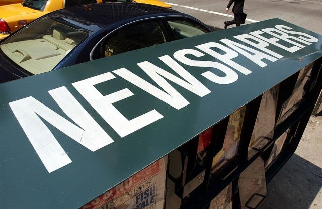 9年前,英國《泰晤士報》率先對網路讀者收費,現在這個訂閱方式已漸漸普及。示意圖。(Getty Images)