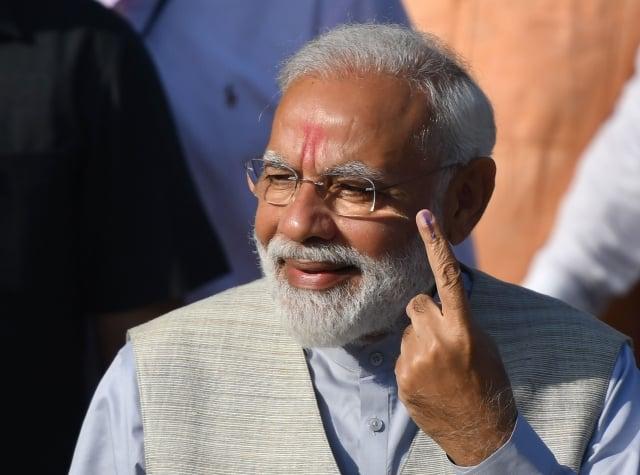 印度國會大選23日將進入最後計票階段,出口民調統計,總理莫迪有望連任。圖為莫迪資料照。(PUNIT PARANJPE / AFP)