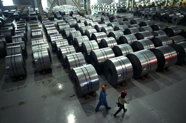 美國商務部宣布,將針對韓國、台灣製造,越南加工後輸美的鋼品課徵456.23%高關稅。(WANG ZHAO / AFP)
