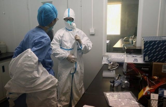為防範中共竊密,美國政府正持續擴大對中國科學家的監控。圖為示意圖。(STR/AFP/Getty Images)
