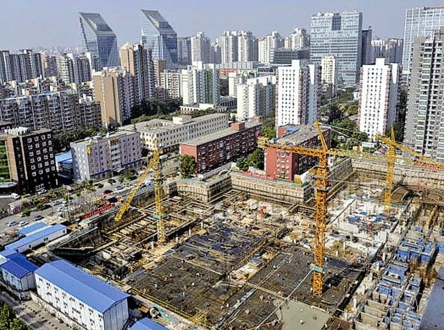 旅美中國經濟專家何清漣則表示,大陸經濟困境緣於內在結構性問題,貿易戰只是雪上加霜。(Getty Images)