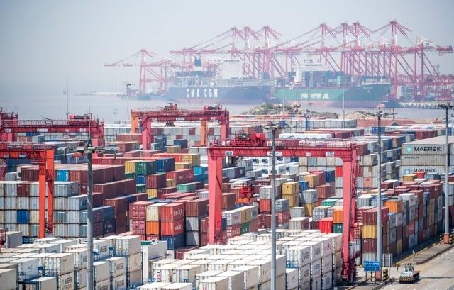 美中貿易戰延燒,重創中國內需市場,加上中國的地方債務問題嚴重,使得各界對中國的GDP表現不樂觀。(Getty Images)