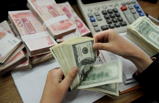 中國約有四分之一的美元計價債券將於2020年到期,規模高達2,011億美元,隨著發行人頻頻傳出無法償債的消息,其境外債券也受到震盪,投資人開始拋售這些不良債券。(Getty Images)