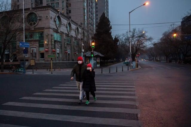 2020年1月28日的北京街頭,空空蕩蕩。 (NICOLAS ASFOURI/AFP via Getty Images)
