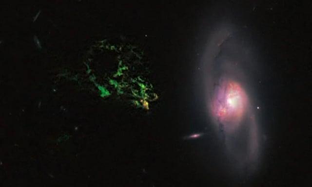 哈尼天體:荷蘭語Hanny's Voorwerp附近,一團發出綠色光的物質,一種解釋稱,是附近一個類星體發出的強烈射線,把氣體雲電離而發光。(NASA/ESA)