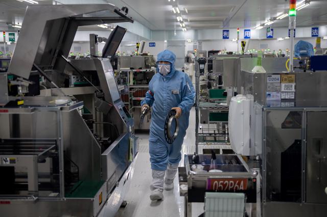 半導體產業是美中攻防的重點產業,牽動各國經濟與國際局勢 (NICOLAS ASFOURI/AFP via Getty Images)