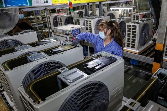 中國《外商投資安全審查辦法》預定18日正式上路,經濟部15日提醒,臺灣投資人適用該辦法。(STR/AFP via Getty Images)