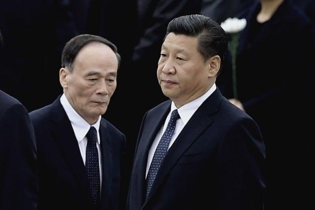 習近平(右)、王岐山(左)。(Getty Images)