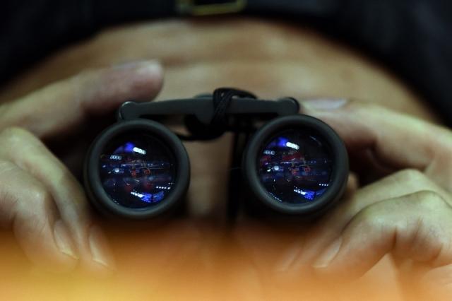 身在海外的異議人士表示,即使在美國和加拿大,也會受到中共的監控。(JOHANNES EISELE/Getty Images)
