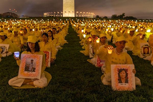 2018年6月22日晚上,來自世界各地的法輪功學員聚集在美國首都華盛頓DC,舉行燭光守夜活動,悼念被中共迫害致死的法輪功學員。(記者Mark Zou/攝影)