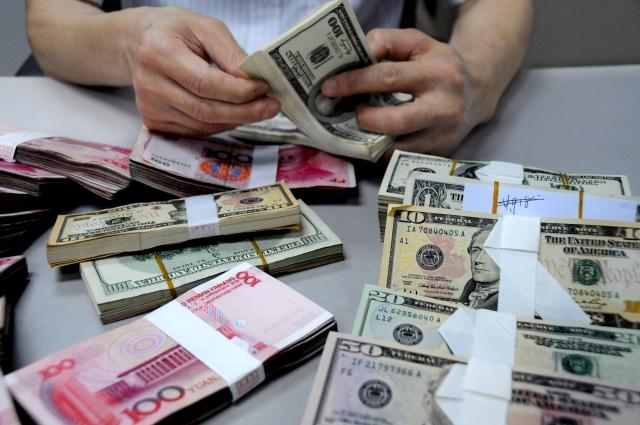 在美國總統川普就人民幣貶值公開發表言論幾小時後,中國人民銀行於上週五(20日)再次下調人民幣中間價。圖為人民幣示意圖。(Getty Images)