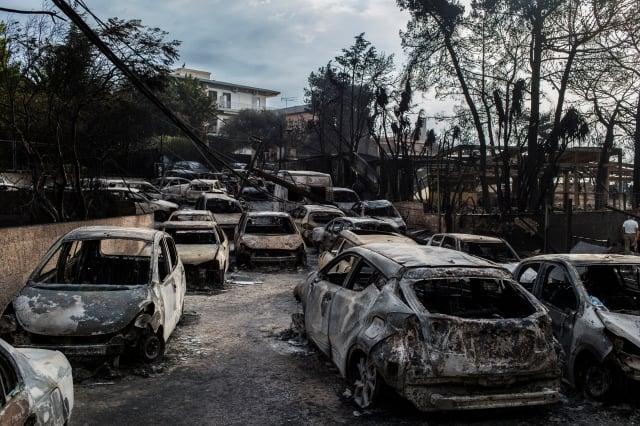 雅典附近的野火至週二已燃燒了一天一夜,這是該國十多年來最嚴重的火災,已造成至少50人喪生,超過100人受傷。(Getty Images)