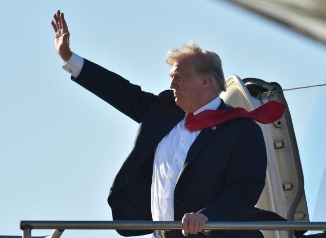 美國總統川普週四(13日)推文說,我們沒有跟中國(中共)達成協議的壓力,是它們(中共)有壓力要跟我們達成協議。(NICHOLAS KAMM/AFP/Getty Images)