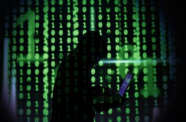 五角大廈近日公布的網路安全戰略稱,美國面臨惡意網路攻擊是「緊急且不可接受的風險」。圖為示意圖。(ROSLAN RAHMAN/AFP)