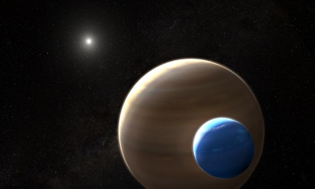 美國哥倫比亞大學的天文學家首次發現系外衛星存在的證據。圖為此衛星與其行星的示意圖。(NASA)