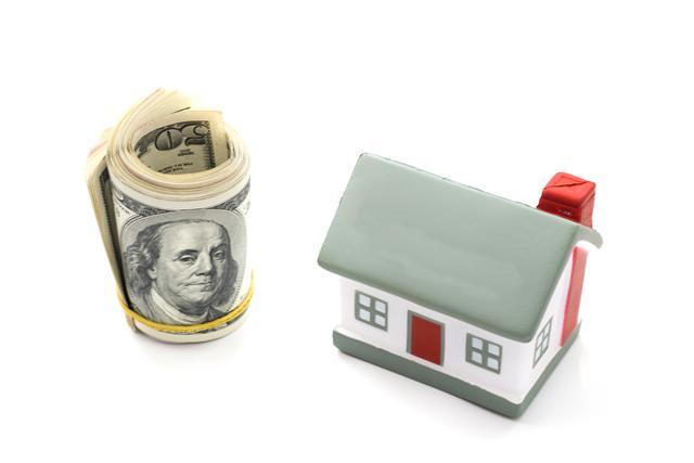 利率節節攀升,有房貸的人,因為利率提高,增加每月負擔。 (Fotolia)
