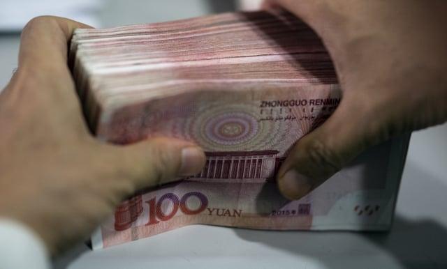 中國的有錢人正忙著把資產及收入轉移到境外信託。圖為示意照。(AFP)