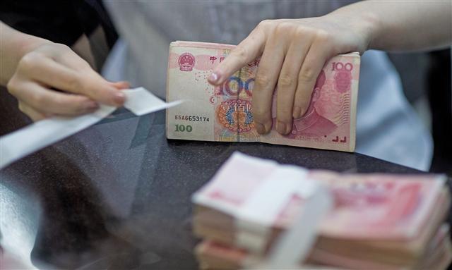 不少台商傳出,中共加強外匯管制力道,嚴管資金外逃。(AFP)