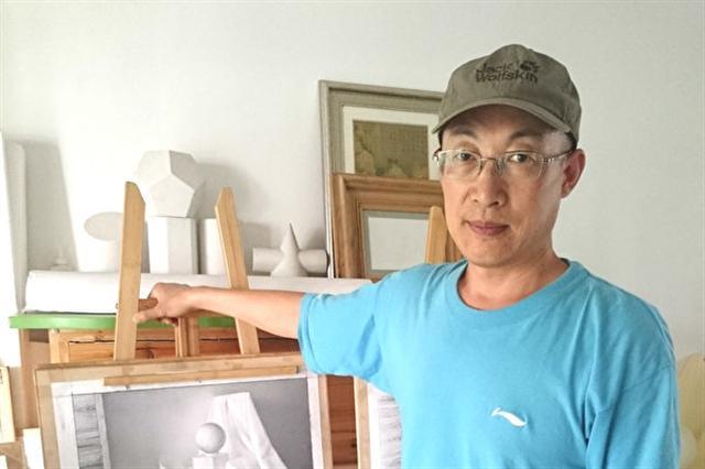 北京畫家秦尉是一名法輪功學員,他堅持信仰卻被非法抓捕。(大紀元)