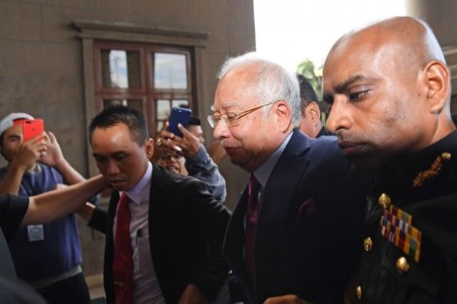 由馬哈地發起的對一馬國家基金的調查導致前總理納吉被捕。(MOHD RASFAN/AFP/Getty Images)