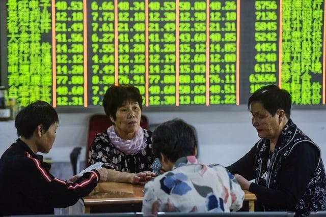 中國手機製造商小米集團的股價重挫,台灣財信傳媒董事長謝金河表示,小股民永遠是最大輸家。(Getty Images)