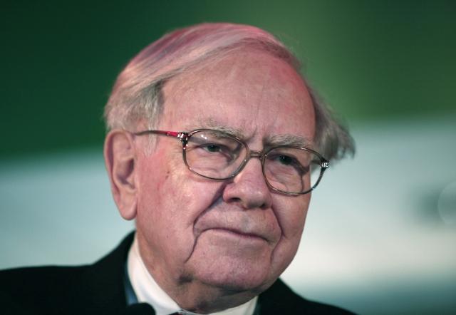 巴菲特認為比特幣是種妄想,吸引的是騙子。圖為資料照。(AFP)