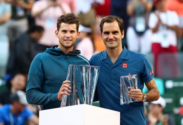 提姆(左)、費德勒(右)。(Getty Images)