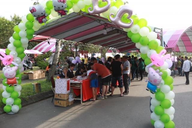 安農溪總體發展協會舉行2019龍神大會志工報到處。