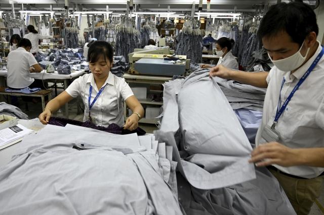 隨著貿易戰爆發,為了避免關稅,不僅美國公司加速回流本土或轉往其它國家,中國公司也大幅加速向東南亞投資。圖為示意照。(Getty Images)