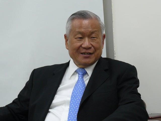 旺宏董事長吳敏求受訪時表示,美中貿易戰對台灣代工廠應有利。(中央社)