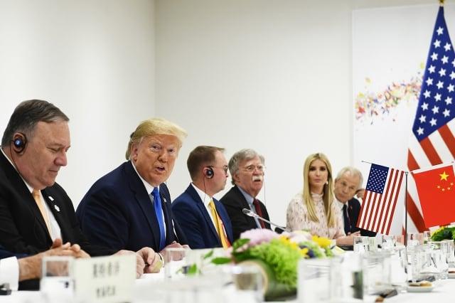 日本大阪時間週六(6月29日)上午11時47分,美國總統川普與中國國家主席習近平舉行午餐會晤。(Brendan Smialowski/AFP)