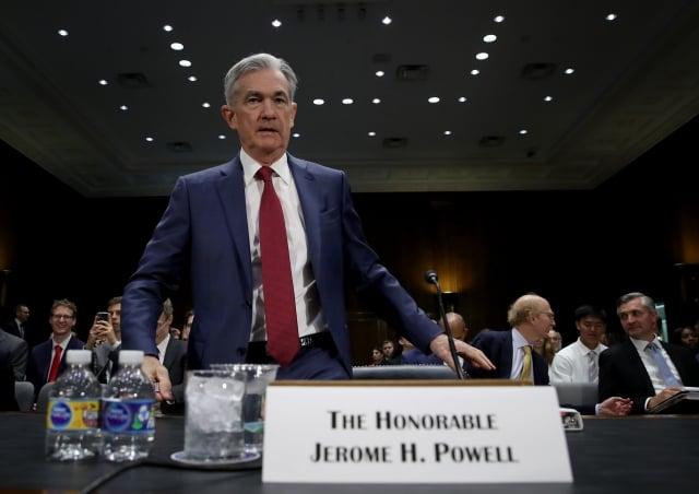 聯準會主席鮑爾表示,嚴重天災風險雖不常與金融機構有關,但美國各銀行越來越需要將天災納入營運計畫考量。(Win McNamee/Getty Images)